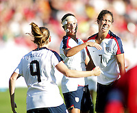 Charli Lloyd (11) celebrates goal and been giving gratulation from Heather O'Reilly (9) and Shannon Boxx (7).  USA 4,  Norway 0, Fredrikstad Stadium, July 2, 2008.