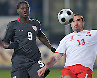 Eddie Johnson of the USA and Marcin Wasilewski of Poland. The United States defeated Poland 3-0 during an international friendly at Wisla Stadium in Krakow, Poland on March 26, 2008.