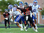 LENNOX, SD, SEPTEMBER 9:  Andrew Oliver #24 from Canton looks for running room past Holdyn Breck #25 from Lennox in the first half of their game Friday night in Lennox. (Photo by Dave Eggen/Inertia)