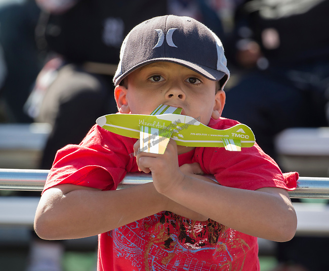 A young fan plays with his toy plane during the National Championship Air Races in Reno, Nevada on Sunday, September 17, 2017.