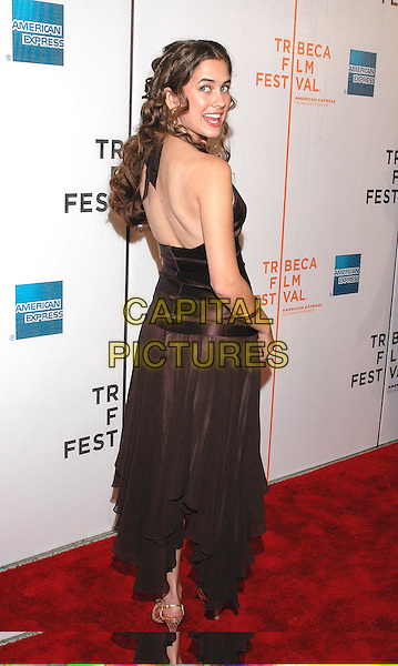 "KATY CHONACAS.Attends the premiere of the new film, ""Slingshot"",  at the Tribeca Film Festival in downtown Manhattan, New York, USA, 26th April 2005..full length brown halterneck dress katie bangles bracelets back backless behind looking over shoulder.Ref: ADM.www.capitalpictures.com.sales@capitalpictures.com.©Patti Ouderkirk/AdMedia/Capital Picture."