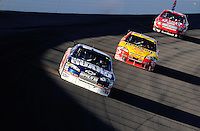 Mar 2, 2008; Las Vegas, NV, USA; NASCAR Sprint Cup Series driver Dale Earnhardt Jr (88) leads Kevin Harvick and Carl Edwards during the UAW Dodge 400 at Las Vegas Motor Speedway. Mandatory Credit: Mark J. Rebilas-US PRESSWIRE