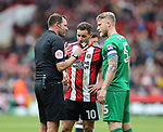 Referee James Linington has words with Billy Sharp of Sheffield Utd and Tom Clarke of Preston North End during the championship match at the Bramall Lane Stadium, Sheffield. Picture date 28th April 2018. Picture credit should read: Simon Bellis/Sportimage
