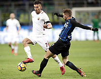 Calcio, Serie A: Inter - Roma, Milano, stadio Giuseppe Meazza (San Siro), 21 gennaio 2018.<br /> Roma's Lorenzo Pellegrini (l) in action with Inter's Davide Santon (r) during the Italian Serie A football match between Inter Milan and AS Roma at Giuseppe Meazza (San Siro) stadium, January 21, 2018.<br /> UPDATE IMAGES PRESS/Isabella Bonotto