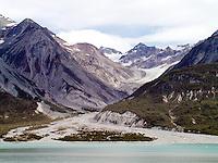 GLACIER<br /> Retreating Carroll Glacier<br /> Glacier retreating leaving behind a carved canyon and debris of glacial moraine.  Glacier Bay, Alaska