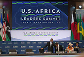 United States President Barack Obama takes his seat next to  Tanzanian President Jakaya Mrisho Kikwete (3rd Right) and African Union Commission Chairperson Dr NC Dlamini Zuma (2nd Right) before participating in ìLeaders Session Three: Governing the Next Generation,î during the Africa Leaders Summit at the State Department in Washington, DC, August 6, 2014.  Obama is promoting business relationships between the United States and African countries during the three-day U.S.-Africa Leaders Summit, where 49 heads of state are meeting in Washington.  <br /> Credit: Molly Riley / Pool via CNP