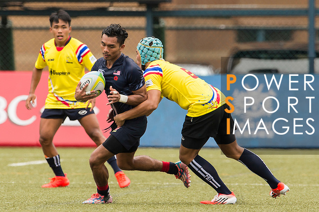 Muhammad Azizul Hakim Bin Che Oon (l) of Malaysia battles for the ball against Thanakrit Booncharoen (r) of Thailand during the match between Malaysia and Thailand of the Asia Rugby U20 Sevens Series 2016 on 12 August 2016 at the King's Park, in Hong Kong, China. Photo by Marcio Machado / Power Sport Images