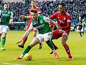 2nd February 2019, Easter Road, Edinburgh, Scotland; Ladbrokes Premiership football, Hibernian versus Aberdeen; Marc McNulty of Hibernian on his debut holds back Max Lowe of Aberdeen