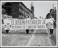 BNPS.co.uk (01202 558833)<br /> Pic: RRAuction/BNPS<br /> <br /> A young John F. Kennedy marching in the Charlestown Bunker Hill Day parade on June 17, 1946, a day before Kennedy was declared the overwhelming winner of the Democratic primary in Massachusetts's 11th congressional district.<br /> <br /> Incredibly-rare photos highlighting the first foray into politics for John F. Kennedy that would eventually cost him his life have come to light.<br /> <br /> The 100 black and white snaps show a youthful-looking JFK from 1946, when he was campaigning to become a US congressman for the first time.<br /> <br /> The tragic future president is seen during an oration lesson where he was given help by an expert with public speaking and posture.<br /> <br /> The 29-year-old is also depicted mingling with the public at an annual parade and as well as celebrating his first political victory - a congressional primary vote - in June 1946.<br /> <br /> The images are being sold by US-based RR Auction.