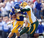 BROOKINGS, SD - SEPTEMBER 28:  Austin Sumner #6 from South Dakota State University is brought down by the facemask by Leevon Perry #69 from North Dakota State University in the first quarter of their game Saturday afternoon at Coughlin Alumni Stadium in Brookings. (Photo by Dave Eggen/Inertia)