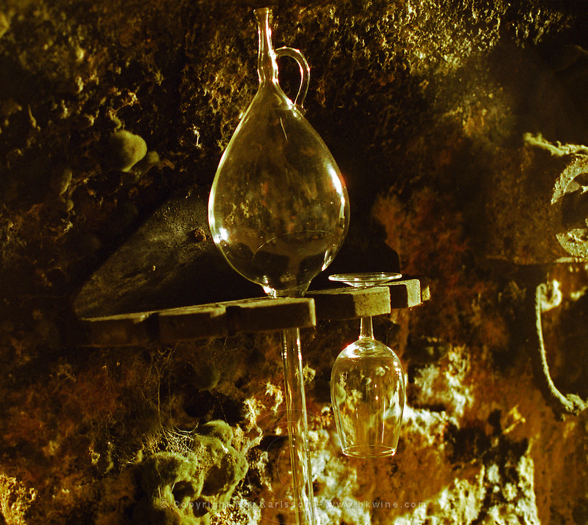 "The Royal Tokaji Wine company in Mad: the wine cellar with long tunnels filled with wooden barrels with ageing Tokaj wine - a glass pipette to take samples from the barrels and a tasting glass hanging on a mouldy wall. The RTWC in was one of the first Tokaj wineries to be ""revived"" by an injection of foreign capital. It makes wine in a traditional style. Credit Per Karlsson BKWine.com"
