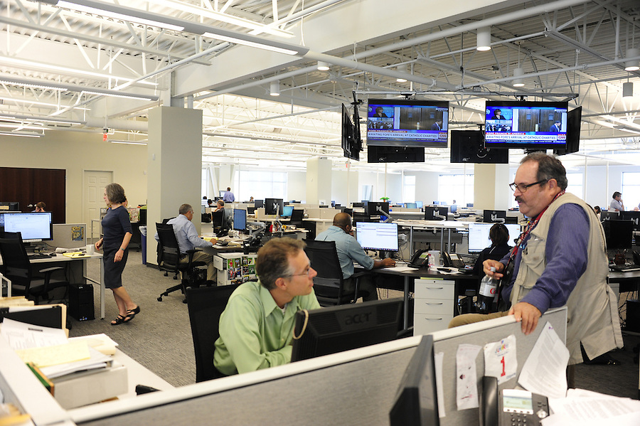 Post-Gazette's new newsroom at 358 North Shore Dr. in Pittsburgh.  Here reporter Rich Lord and photographer Larry Roberts confer on a project. Tim Martin AME News for the Pittsburgh Post-Gazette retires September, 2015
