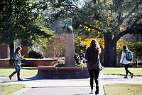 Students walking on Drill Field near Stephen D. Lee statue.<br />  (photo by Megan Bean / &copy; Mississippi State University)