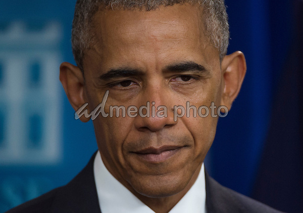 United States President Barack Obama listens  to a question after delivering remarks on the US Supreme Court decision on immigration in the press briefing room of the White House in Washington, DC, USA, 23 June 2016. Photo Credit: Molly Riley/CNP/AdMedia