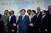 Justin Trudeau, Canada's prime minister, center, gestures as he walks out of a family photo at the Nuclear Security Summit in Washington, D.C., U.S., on Friday, April 1, 2016. After a spate of terrorist attacks from Europe to Africa, U.S. President Barack Obama is rallying international support during the summit for an effort to keep Islamic State and similar groups from obtaining nuclear material and other weapons of mass destruction. <br /> Credit: Andrew Harrer / Pool via CNP