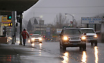 Traffic moves through downtown Carson City, Nev., as a heavy, wet storm hits the Northern Nevada region on Sunday, Dec. 2, 2012. (AP Photo/Cathleen Allison)