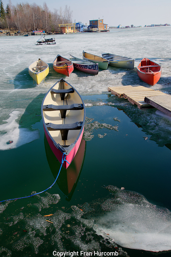 breakup and canoes at dock