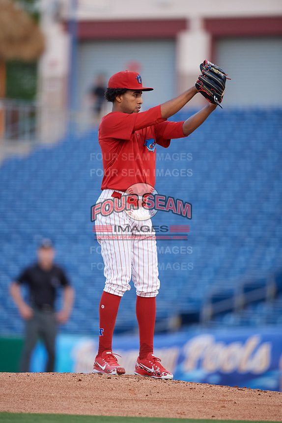 Clearwater Threshers starting pitcher Adonis Medina (18) gets ready to deliver a pitch during a game against the Jupiter Hammerheads on April 12, 2018 at Spectrum Field in Clearwater, Florida.  Jupiter defeated Clearwater 8-4.  (Mike Janes/Four Seam Images)