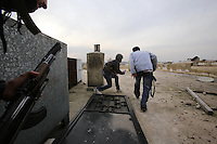 Photographer: Rick Findler/Borderline News..18.01.13 Members of the Free Syrian Army get onto a roof top to attack a group of President Assad's forces with gun-fire and a home-made explosive device in the heart of Aleppo, Norhtern Syria.