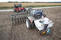 Filling tank with slug pellets, drilling oil seed rape - Lincolnshire, August
