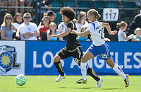 Eriko Arakawa runs for the ball with Nancy Augustyniak Goffi (25).FC Gold Pride defeated the Boston Breakers 2-1 at Buck Shaw Stadium in Santa Clara, California on April 5th, 2009.