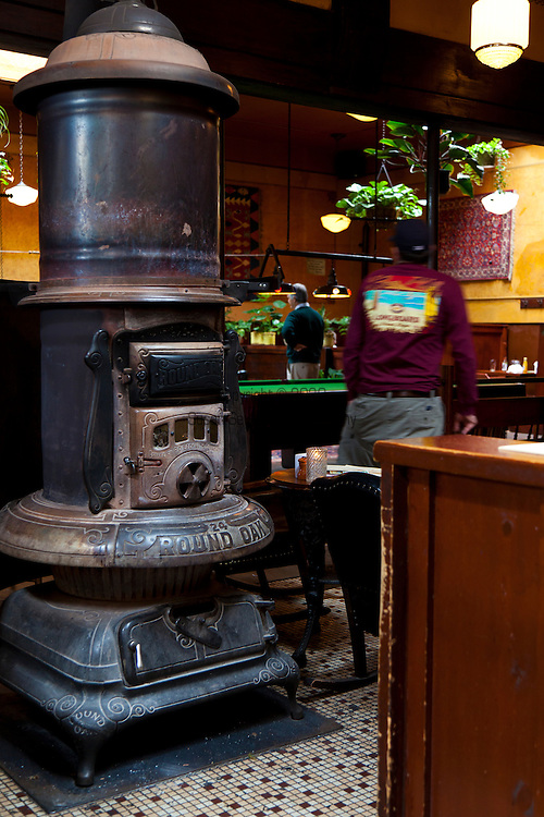 """The original """"Round Oak"""" wood burning fire place in the center of McMenamin's Olympic Club Pub in Centralia, Washington State."""