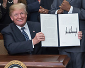 United States President Donald J. Trump signs a proclamation to honor Dr. Martin Luther King, Jr. Day in the Roosevelt Room of the White House in Washington, DC on Friday, January 12, 2018.<br /> Credit: Ron Sachs / CNP