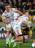 Damien McKenzie hands off Ngani Laumape during the Super Rugby match between the Hurricanes and Chiefs at Westpac Stadium in Wellington, New Zealand on Friday, 9 June 2017. Photo: Dave Lintott / lintottphoto.co.nz