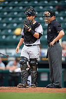 Jupiter Hammerheads catcher Chris Hoo (18) talks with umpire Sam Burch during a game against the Bradenton Marauders on May 25, 2018 at LECOM Park in Bradenton, Florida.  Jupiter defeated Bradenton 3-2.  (Mike Janes/Four Seam Images)