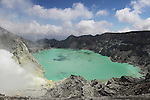 Kawah Ijen Volcano, Java, Indonesia acidic crater lake, and gases from burning sulfur deposits.