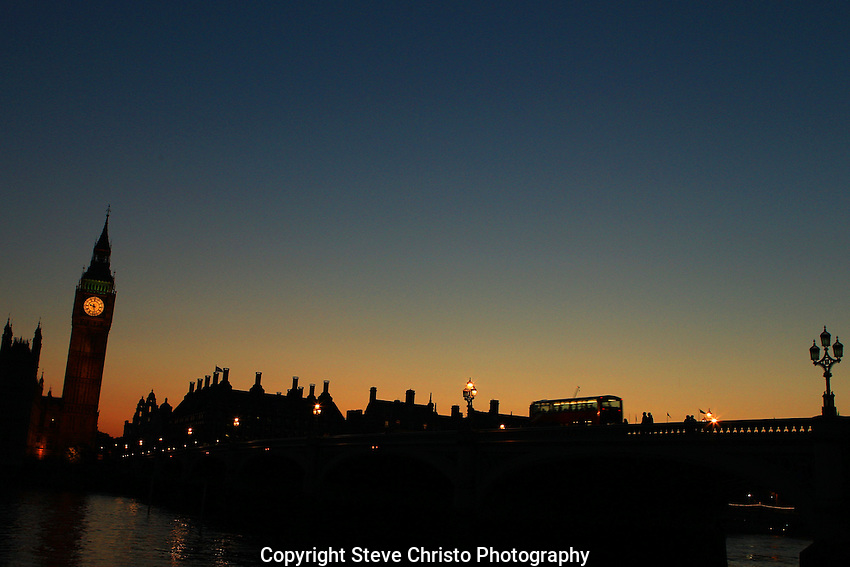 The sun sets on Big Ben and the Houses of Parliament on the river Thames in London. 22nd July 2012. Photo Steve Christo.