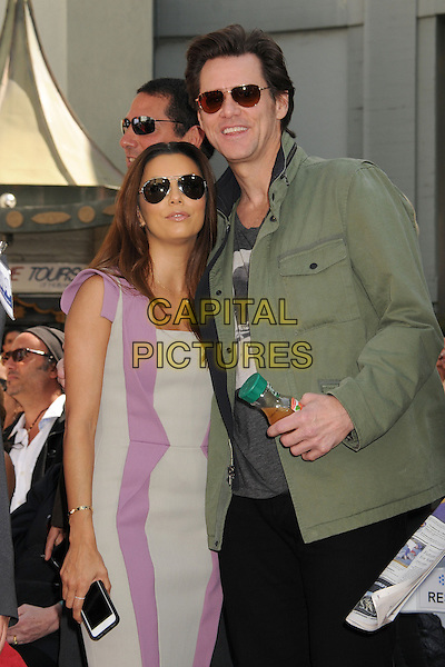 Eva Longoria, Jim Carrey.TCM Classic Film Festival 2013 - Jane Fonda Handprint and Footprint Ceremony held at the TCL Chinese Theatre, Hollywood Walk of Fame, Hollywood, California, USA, 27th April 2013..half length green khaki jacket sunglasses purple grey gray dress aviators.CAP/ADM/BP.©Byron Purvis/AdMedia/Capital Pictures