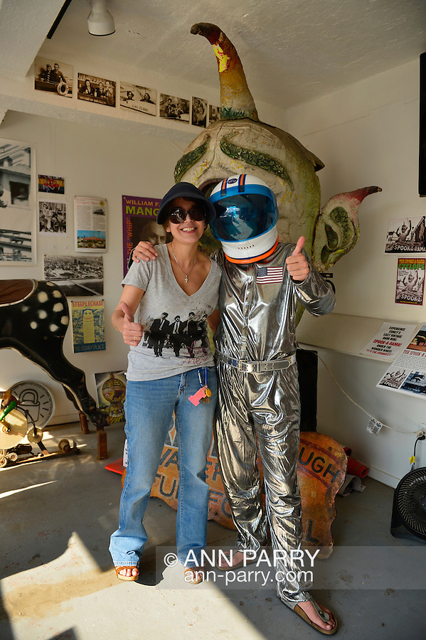 L-R, STACY VOURDERIS, co-founder of Coney Island History Project, and Space Cadet are next to Spook-A-Rama Cyclops at The Fourth Annual History Day at Deno's Wonder Wheel Amusement Park.