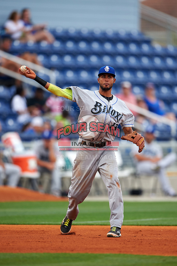 Biloxi Shuckers third baseman Yadiel Rivera (13) throws to first during the second game of a double header against the Pensacola Blue Wahoos on April 26, 2015 at Pensacola Bayfront Stadium in Pensacola, Florida.  Pensacola defeated Biloxi 2-1.  (Mike Janes/Four Seam Images)