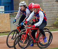 19 APR 2015 - IPSWICH, GBR - Josh Brooke (left) and Matt Hill (right) of Ipswich Eagles block a Sheffield Stars rival as they head for the first corner during their Elite League cycle speedway fixture at Whitton Sports and Community Centre in Ipswich, Suffolk, Great Britain (PHOTO COPYRIGHT © 2015 NIGEL FARROW, ALL RIGHTS RESERVED)