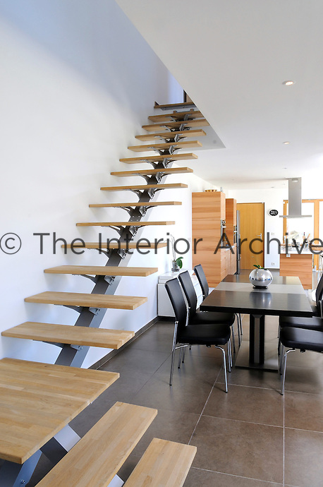 A simple cantilevered open staircase leads from the open plan kitchen/dining area of La Villa Vision to the rooms on the first floor
