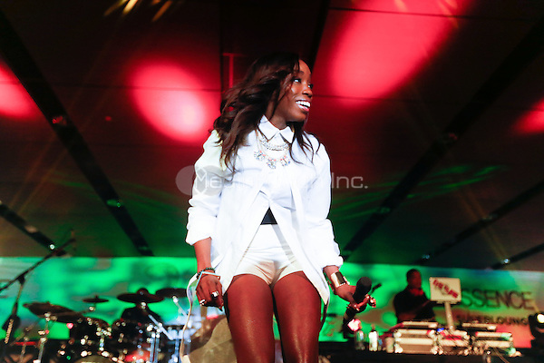 NEW ORLEANS - JULY 4: Estelle performs in the Essence Superlounge at the 2014 Essence Festival at the Superdome in New Orleans, Louisiana on July 4, 2014. Credit: PGHingle/MediaPunch
