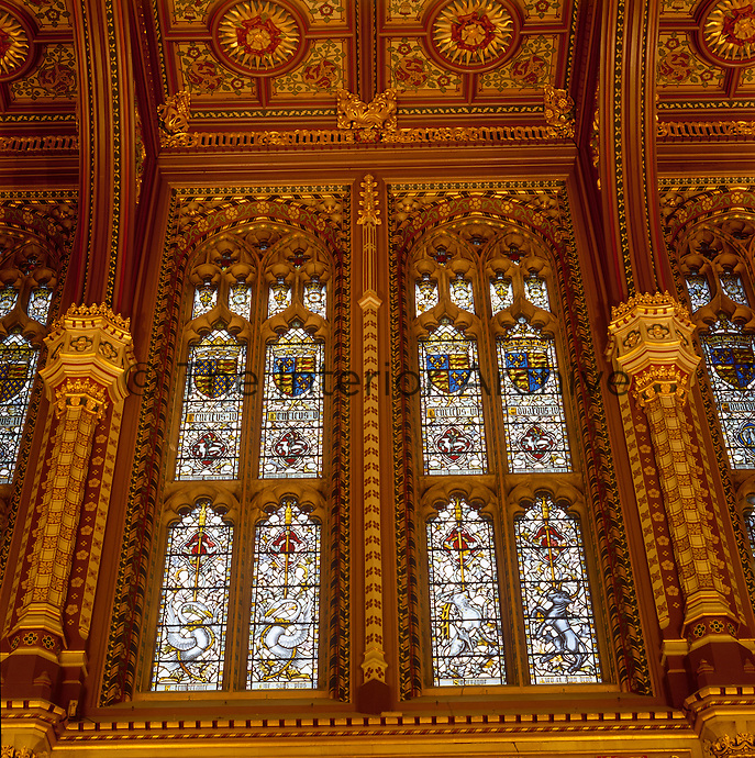Stained glass windows in the Royal Gallery show post World War II reproductions of Pugin's designs for heraldry of English and Scottish monarchs