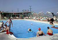 1958 photograph of families enjoying the Seacomber Motel pool.