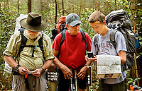 Troop 10 Boy Scouts orient their maps during a spring backpacking in the South Mountains State Park in Connelly Springs, North Carolina.