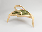 Enignum Free Form Chair, 2014; Designed and made by Joseph Walsh (Irish, b. 1979) and Joseph Walsh Studio (Cork, Ireland); Olive ash wood stripped into thin layers, then manipulated and reconstructed, suede upholstery; 70 × 125 × 106.5 cm (27 9/16 × 49 3/16 × 41 15/16 in.); Gift of Joseph Walsh, 2015-39-1; Photo:   Matt Flynn © Smithsonian Institution