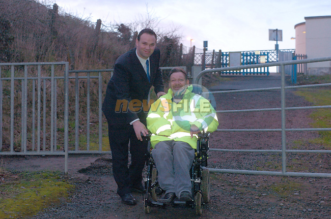 Meath labour canidate Shane Cassidy with Patrick Gogarty at the entrance to laytown Train Station which patrick cannot get to in his wheelchair...Photo Fran Caffrey Newsfile.ie..This Picture has been sent to you by Newsfile Ltd..The Studio,.Millmount Abbey,.Drogheda,.Co. Meath,.Ireland..Tel: +353(0)41-9871240.Fax: +353(0)41-9871260.ISDN: +353(0)41-9871010.www.newsfile.ie..general email: pictures@newsfile.ie