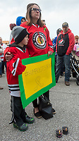 Stephanie Dunlop and her six-year-old son Cole, a Point Edward minor hockey player.<br /> <br /> An estimated crowd of around 200 (Point Edward OPP) turned out for a candle light vigil to remember 15 players and management of the Humboldt Broncos hockey team killed in a bus crash in Saskatchewan.