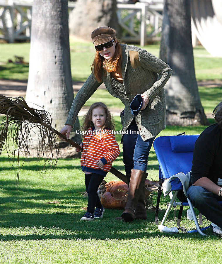 2-7-2010..Marcia Cross & Tom Mahoney playing with  there kids Eden and Savannah, on at a park in Los Angeles.  Marcia was drinking coffe & pushing the stroller. ...Abilityfilms@yahoo.com.805-427-3519.www.AbilityFilms.com.