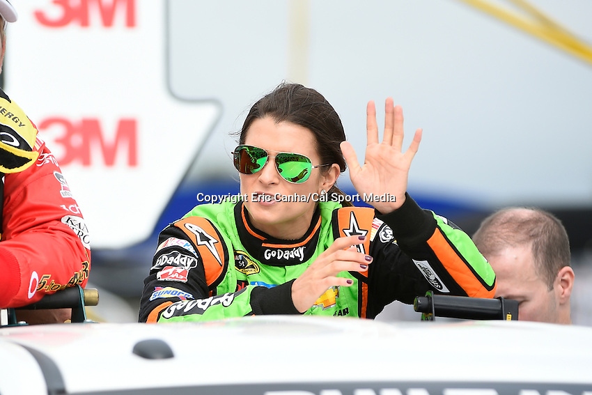 September 21, 2014 - Loudon, New Hampshire, U.S. -  Sprint Cup Series driver Danica Patrick (10) is driven to her car for the start of the Nascar Sprint Cup Series Sylvania 300 race held at the New Hampshire Motor Speedway in Loudon, New Hampshire.   Eric Canha/CSM