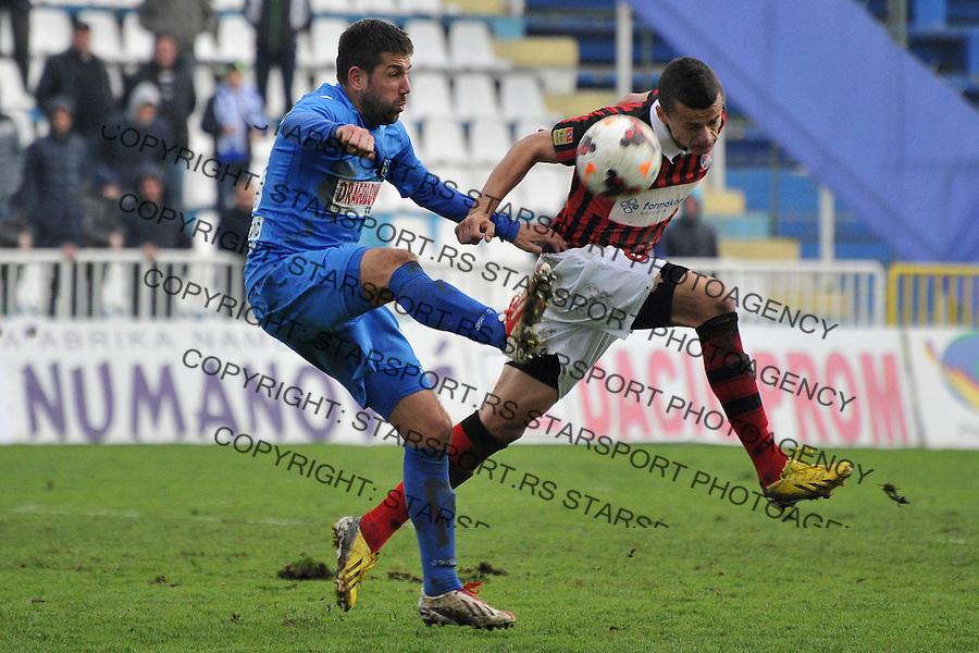 Fudbal Super liga season 2013-2014<br /> Novi Pazar v Sloboda Point<br /> Nemanja Arsenijevic (#99) FK Novi Pazar u duelu sa Borislav Terzic (#44) FK Sloboda Point<br /> Novi Pazar, 8. 3. 2014.<br /> foto: Emir Sadovic/Starsportphoto &copy;