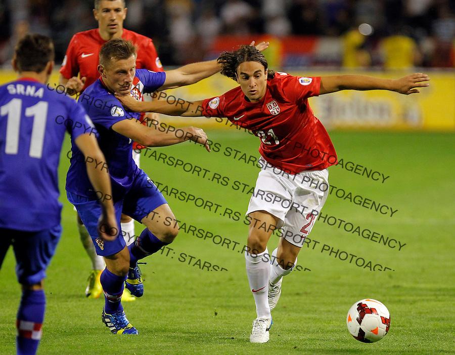 Fudbal Soccer<br /> World Cup 2014 qualifiers match<br /> Serbia v Croatia<br /> Lazar Markovic (R) and Ivica Olic<br /> Beograd, 06.09.2013.<br /> foto: Srdjan Stevanovic/Starsportphoto &copy;