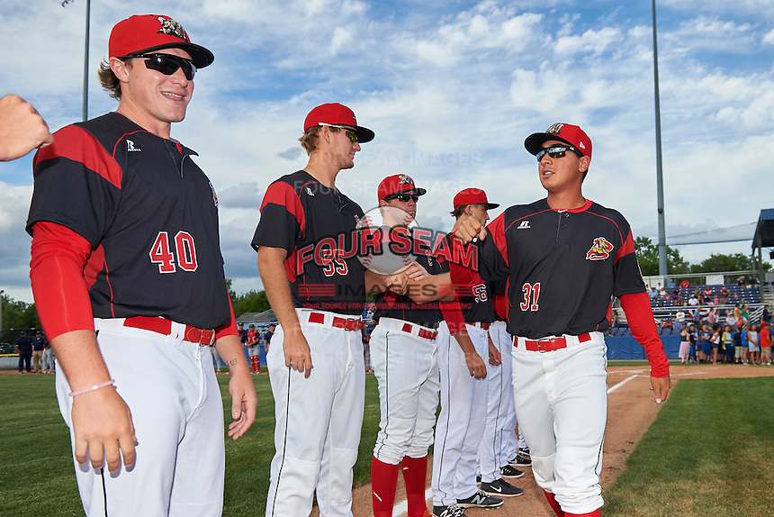 Batavia Muckdogs pitcher Ty Provencher (31) fist bumps teammates including Justin Langley (55) and Ryley MacEachern (40) before a game against the State College Spikes on June 22, 2016 at Dwyer Stadium in Batavia, New York.  State College defeated Batavia 11-1.  (Mike Janes/Four Seam Images)