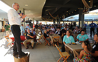 NWA Democrat-Gazette/ANDY SHUPE<br /> Gov. Asa Hutchinson speaks Thursday, Sept. 17, 2015, from atop a stump to a large crowd during the fifth annual Chickin, Peelin' & Politickin' at Arvest Ballpark in Springdale. Regional civic and business leaders have the opportunity to speak with national, state, regional and local political leaders and elected officials at the event, which is organized by the Springdale Chamber of Commerce.
