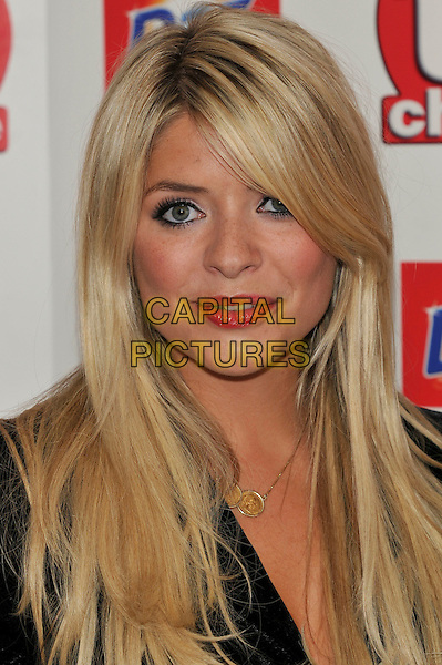 HOLLY WILLOUGHBY .Attending the TV Choice Awards 2010 at The Dorchester, London, England, UK, September 6th, 2010..arrivals portrait headshot  black red lipstick make-up gold necklace .CAP/PL.©Phil Loftus/Capital Pictures.